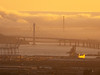 Bay Bridge, Golden Gate Bridge, and Golden Light over Port of Oakland