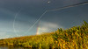 Fly Line and Rainbow over Marsh