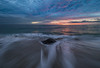 Breaking Waves and Flowing Water Patterns Before Sunrise