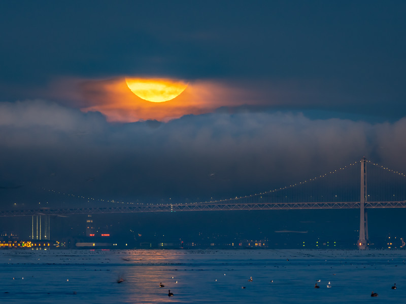 Bay Bridge and Setting Full Moon Shrouded by Fog