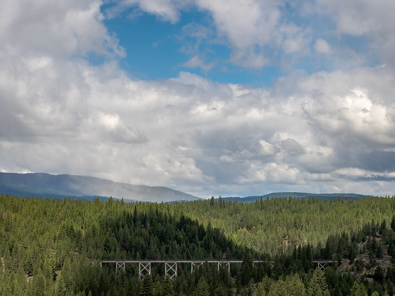 Train Trestle and Landscae with Dappled Light and Stormy Sky
