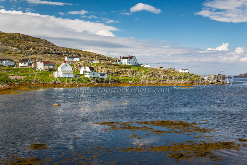 The fishing village with boats and stages at Fogo, Fogo Island, Newfoundland and Labrador, Canada.