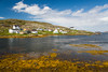 The fishing village with boats and stages near Fogo, Fogo Island, Newfoundland and Labrador, Canada.