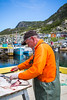 Cleaning cod fish at Bauline, Newfoundland and Labrador, Canada.