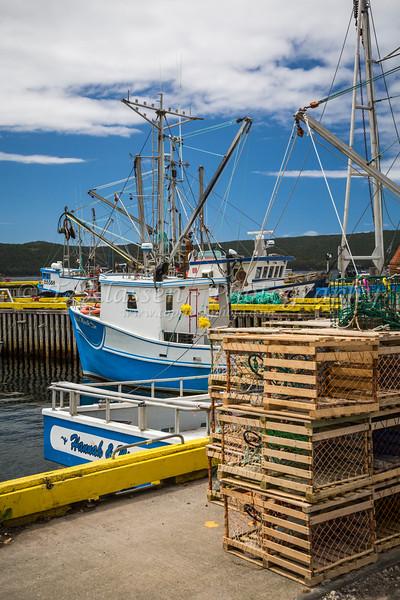A small wharf and fishing boats near Bay Roberts, Newfoundland and Labrador, Canada.