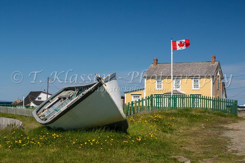 A fishing dory and salt box house at Bonavista, Newfoundland and Labrador, Canada.