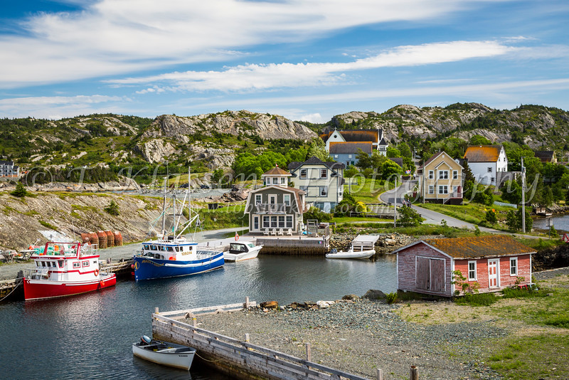 Fishing boats at the wharf in the harbour of the picturesque fishing village of Brigus, Newfoundland and Labrador, Canada.