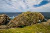 Bird rock and the rugged Cape Bonavista coastline, Newfoundland and Labrador, Canada.
