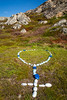 A stone rosary at the Mary Queen of the World Roman Catholic Church at Joe Batt's Arm-Barr'd Islands-Shoal Bay, Newfoundland and Labrador, Canada.