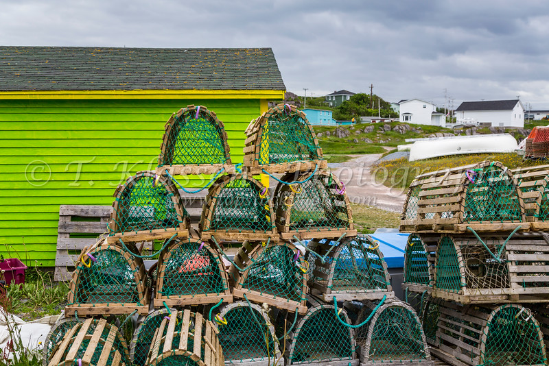 A lime green fish stage and lobster traps in Old Perlican, Newfoundland and Labrador, Canada.