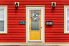 A colorful home entrance door in the village of Freshwater, Newfoundland and Labrador, Canada.