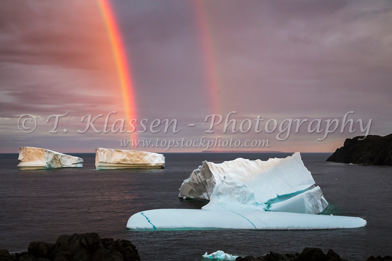 Icebergs and rainbow off the coast near St. Anthony, Newfoundland and Labrador, Canada.