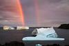 Icebergs and rainbow off the coast near St. Anthony, Newfoundland and Labrador, Canada.