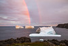 Icebergs with rainbow off Fisherman's Point in St. Anthony, Newfoundland and Labrador, Canada.
