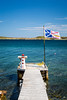 A boat dock and Newfoundland flag near St. Anthony, Newfoundland and Labrador, Canada.