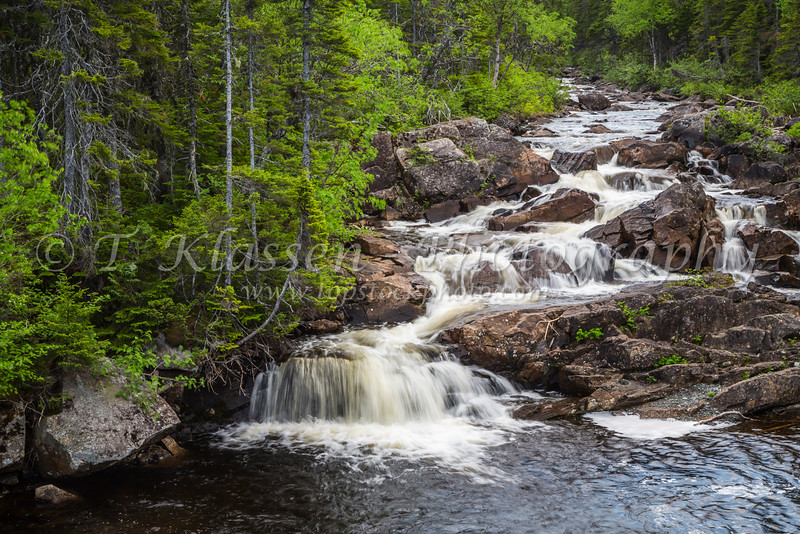 A small stream with waterfalls near St. Anthony, Newfoundland and Labrador, Canada.