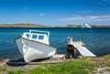 A boat dock and Newfoundland flag near St. Anthony, Newfoundland and Labrador, Canada.
