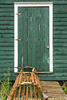 A green door of a fishing stage at Trout River, Newfoundland and Labrador, Canada.