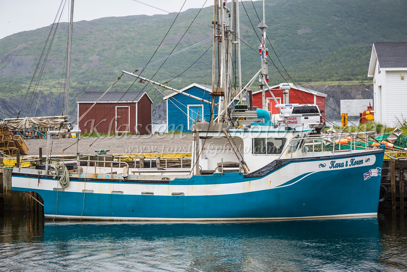 The fishing village harbour with fishing boats and colorful fishing stages at Trout River, Newfoundland and Labrador, Canada.