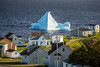 Homes and icebergs in the waters at Twillingate, Newfoundland and Labrador, Canada.