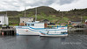 Large and small boat with matching paint jobs, harbour, Trout River, Newfoundland