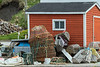 Red fishing shack with lobster and crab traps, Trout River, Newfoundland