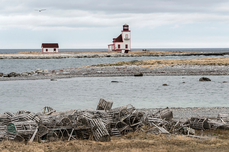 Flower's Island lighthouse looking SE with lobster traps, Nameless Cove, Newfoundland