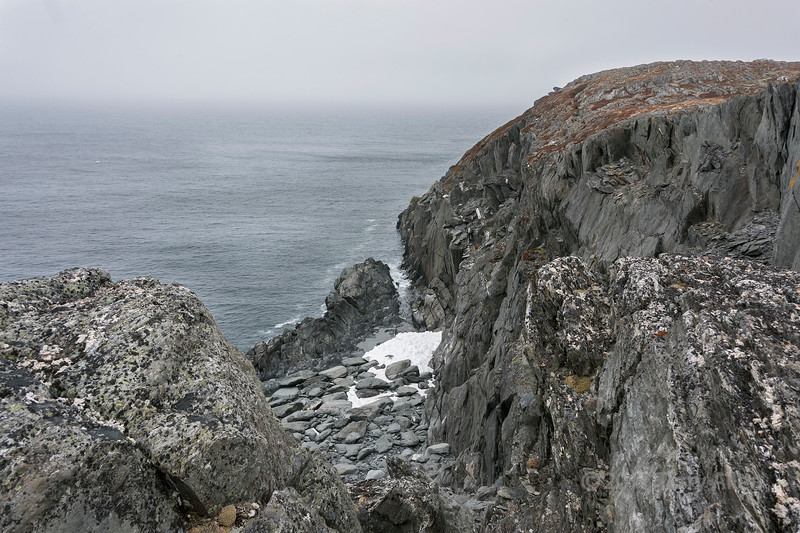 Lingering June snow and rocky beach, Quirpon Island, Strait of Belle Isle, Newfoundland