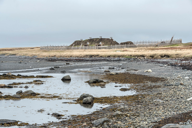 View of the Viking sod longhouse from the shore of Islands Bay, L'anse aux Meadows Historic Site, Newfoundland