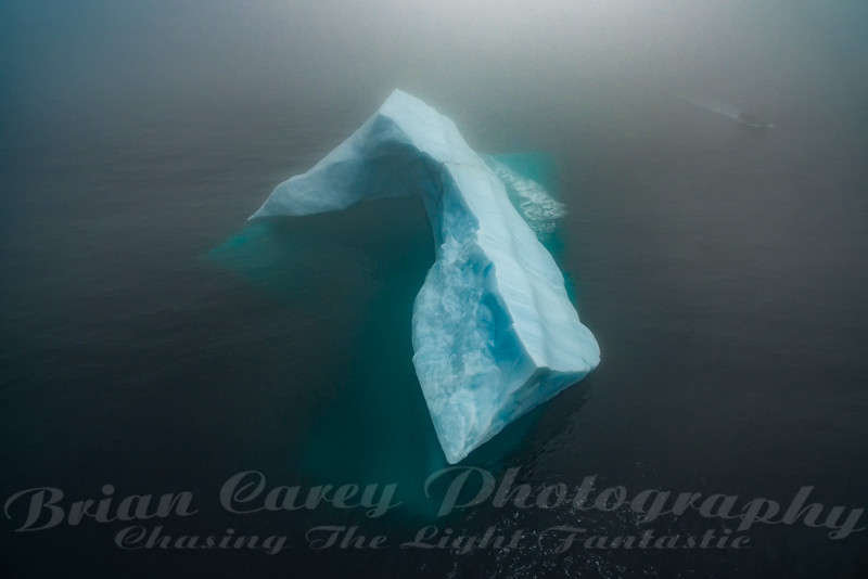Iceberg and Tour Boat in the Fog