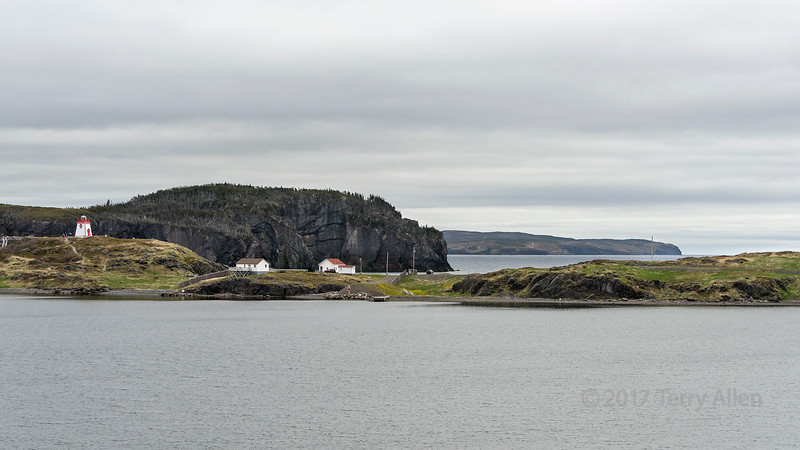 Fort Point Lighthouse, 1874, protecting the harbour, Trinity, Newfoundland<br /> Fort Point was established in 1748 by the British in order to protect the mercantile assets that had been established in Trinity. The Fort was destroyed in 1762 by the French during a take over of the Town however was rebuilt in 1812. The site in 1871 became a Light House Station and was operated as such with a year round Light House Keeper until the 1990s.. Work on constructing a lighthouse on Fort Point to mark the entrance to Trinity Harbour began in 1872. The signature of this light, and the current tower that was built around 2003, is a white flash every five seconds. Fort Point Lighthouse is still a staffed station. The original apparatus was a dioptric (invented by Sir David Brewster, predating but similar to the Fresnel lens, ) of the 8th order, with a single argand burner.