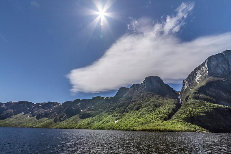 Sun burst over Western Brook Pond fjord, Gros Morne National Park, Newfoundland