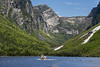 Western Brook II tour boat minaturized by the cliffs, Western Brook Pond, Gros Morne National Park, Newfoundland