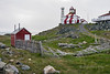 Cape Bonavista lighthouse with red shed and stick fence, Newfoundland