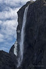 Waterfall and snow, Western Brook Pond, Gros Morne National Park, Newfoundland