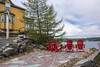 View over Fisher Cover with red Adirondack chairs, Trinity Newfoundland