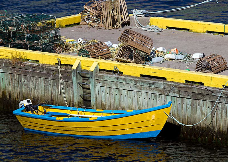 Yellow and Blue Rowboat at Pier