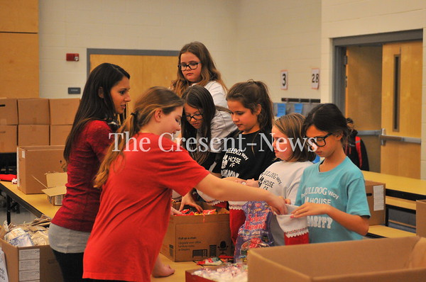11-28-17 NEWS Stuffing stockings for Soldiers