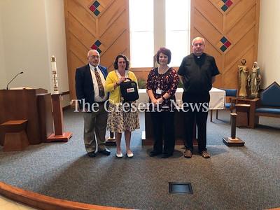 05-09-18 NEWS Holy Cross AED, TM