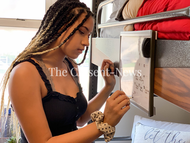 College freshman India Carter fills in the whiteboard calendar in her dorm room at The Ohio State University. Scheduling healthy habits just like she schedules her classwork helps her manage her health.