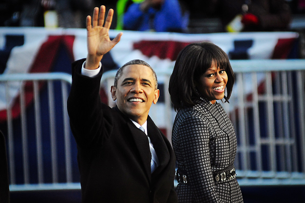 President Barack Obama and First Lady Michelle Obama walk the parade route following the 57th presidential inauguration in Washington D.C. on Jan. 21, 2013.