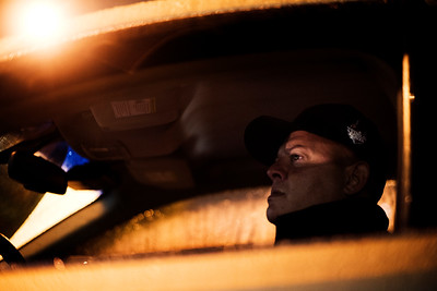 Boston University Police Sergeant Larry Cuzz watches for underage students from an unmarked police cruiser parked by a liquor store near the BU campus as part of an effort to cut down underage drinking at the university on October, 1, 2016 in Boston. For The New York Times.
