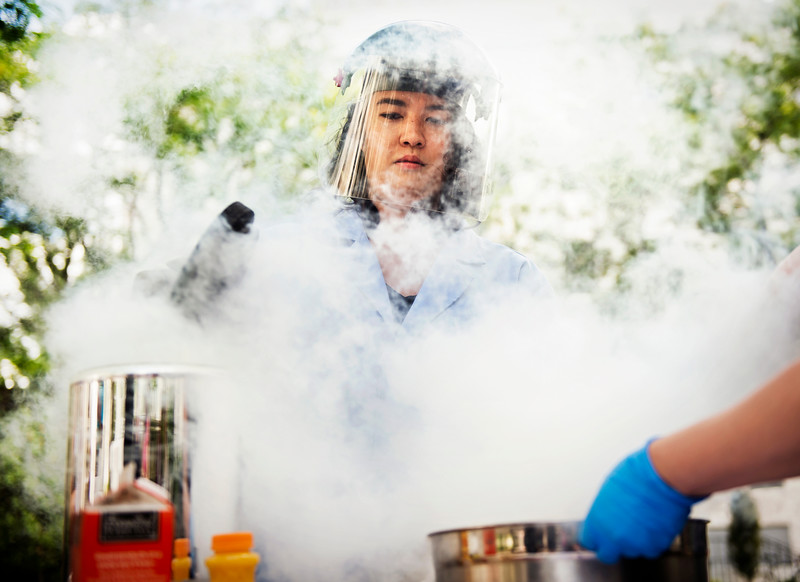 Northeastern Ph.D. student Michelle Stolzoff makes ice cream with liquid nitrogen in Robinson Quad on August 12, 2015.