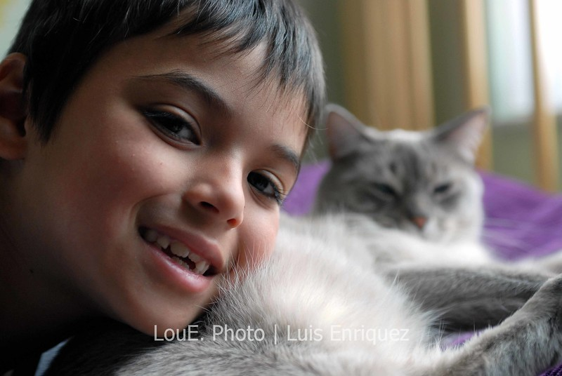 June 5, 2007<br /> <br /> My nephew snuggling with his cute kitty.  He hardly ever smiles for the camera but he just cant help himself when that fur brushes across his face along with the loud purring.