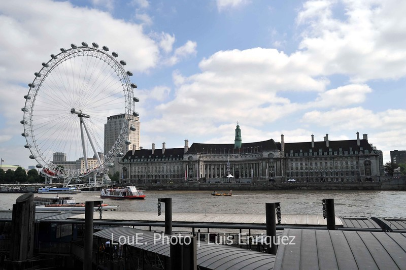 """August 15, 2009<br /> <br /> London Eye and County Hall<br /> London, UK<br /> <br /> The largest ferris wheel in Europe and one of the biggest tourist attractions in London.  Too bad the line up was near the length of the River Thames!!  I dont think I have ever said this before but """"There were too many tourists!!""""<br /> The County Hall, having once served as the headquarters of local government, is now home to a museum, hotel, aquarium, and restaurants.  I made my way to a sushi restaurant inside the County Hall not because I was hungry but because a situation had become touch and go."""
