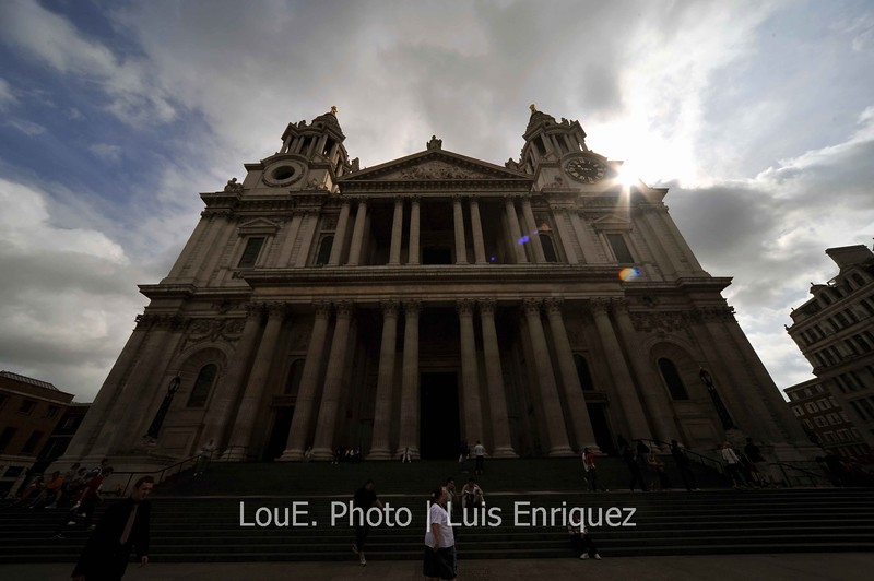 August 14, 2009<br /> <br /> St. Paul's Cathedral<br /> London, UK<br /> <br /> Okay wait, one more shot.<br /> It was mid week and early enough in the morning that tourists were in smaller numbers and I was able to concentrate on taking some decent shots.  Although the perspectives are warped due to the ulra wide angle, I thought this was an interesting one with the sun peeking out.  Yes, my DR was on high in case you were wondering.