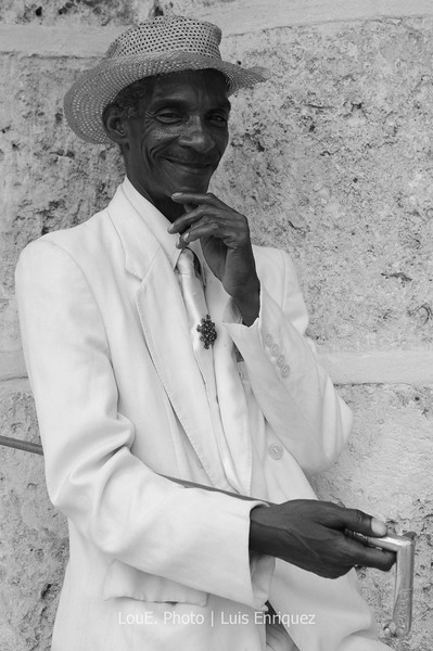 April 20, 2009<br /> <br /> Another character with a classic pose.  This guy definitely knew how to pose although I chose the background for him.  Definitey a keeper.<br /> <br /> Well, thats a few of the many hundreds I took of Old Havana.  There are many more in the Havana category under Portfolio.  Cuba is a beautiful country and definitely a photographer's dream.