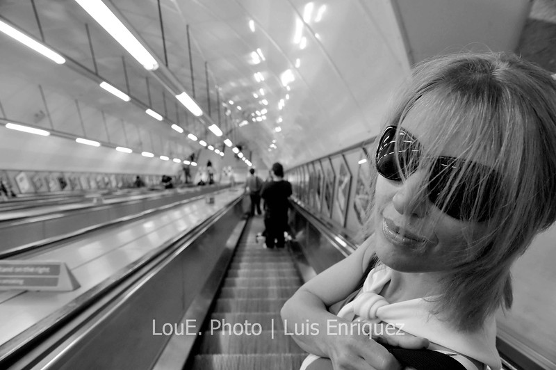 """August 15, 2009<br /> <br /> Underground<br /> London, UK<br /> <br /> Not only is it too expensive to rent a car but  I probably would've killed myself trying to drive in London.  So it was by foot and by underground that we made our way around London.  I have to admit it was quite intimidating at first looking at the huge map and all of the train lines intersecting but soon after it became not only quite easy to follow but  very efficient as well.  I could do without the crowds though.  I find the Londoners generally eager to have their way and seem to be in such a hurry to get somewhere.<br /> Thats my sweetie giving me the """"stop taking pictures...wait let me see...take another one""""."""