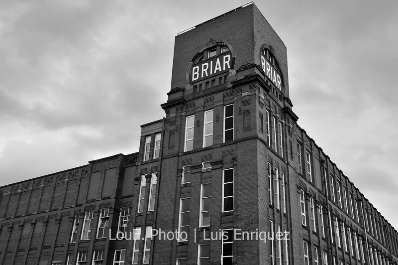 August 12, 2009<br /> <br /> Briar Mill<br /> Shaw, Greater Manchester, UK<br /> <br /> Many of the cotton mills that supported the local economy for over a century have closed but the buildings remain standing.  A few have been converted for other commercial uses but most remain vacant and have been for over 50 years.<br /> I would love to do a book on these beautiful giant buildings both from the outside and the inside showing its history and the beauty of decaying abandonement.  Maybe on the next trip...