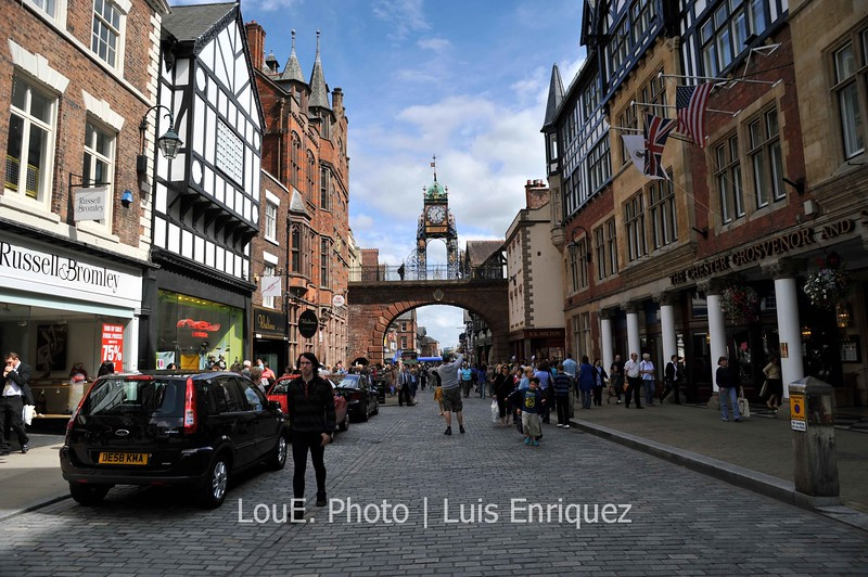 August 18, 2009<br /> <br /> Chester, UK<br /> <br /> A bit of a tourist shot of Eastgate Street to show the roman remains and victorian buildings.  In the distance is the Eastgate Clock, a city landmark on top a stone archway which is part of the city wall.